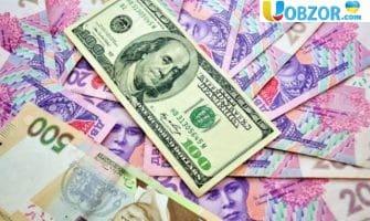 Долар сьогодні впав ще на дев'ять копійок (28,04 гривень)